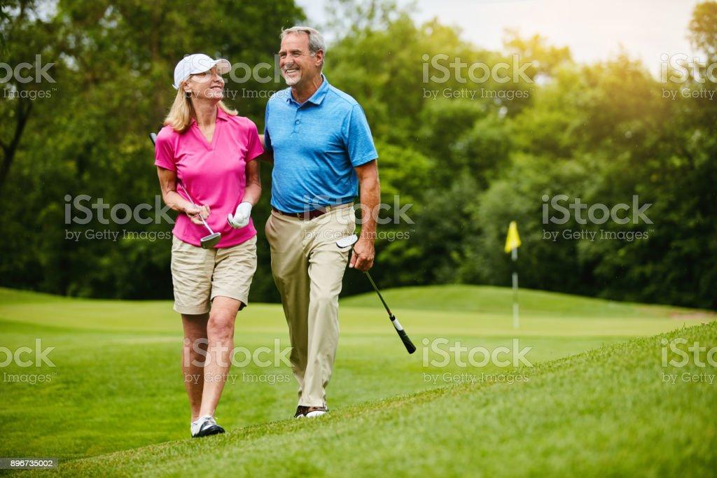 Compartimos el amor por el golf - foto de stock
