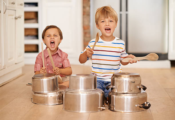 We starting a band baby!!!!! Two adorable young brothers using kitchen utensils as instrumentshttp://195.154.178.81/DATA/i_collage/pi/shoots/783660.jpg drum percussion instrument stock pictures, royalty-free photos & images