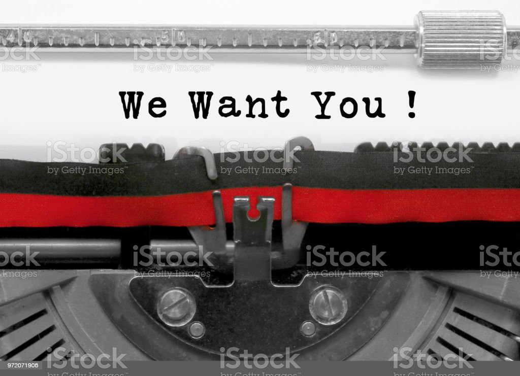 We want you text by the old typewriter on white paper stock photo