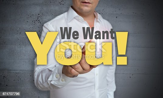 We Want You touchscreen is operated by man.