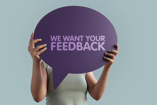 We want your feedback word with speech bubble