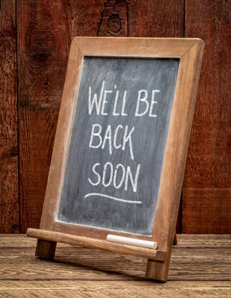 We will be back soon blackboard sign. stock photo