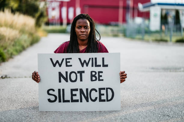 """""""We will not be silenced"""" placard stock photo"""