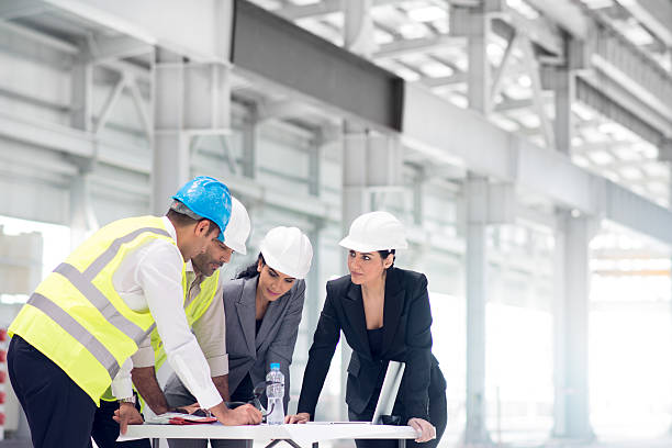 We will set the furnaces here! Group of arabic architects and managers coordinating construction. project manager stock pictures, royalty-free photos & images