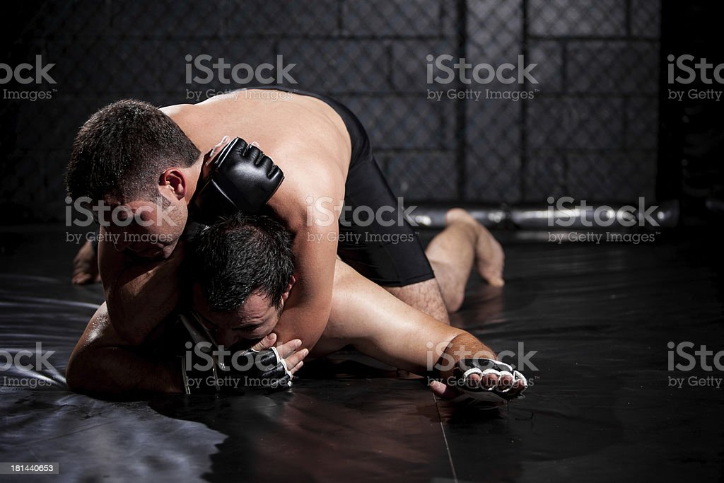 Weak MMA fighter about to tap out stock photo