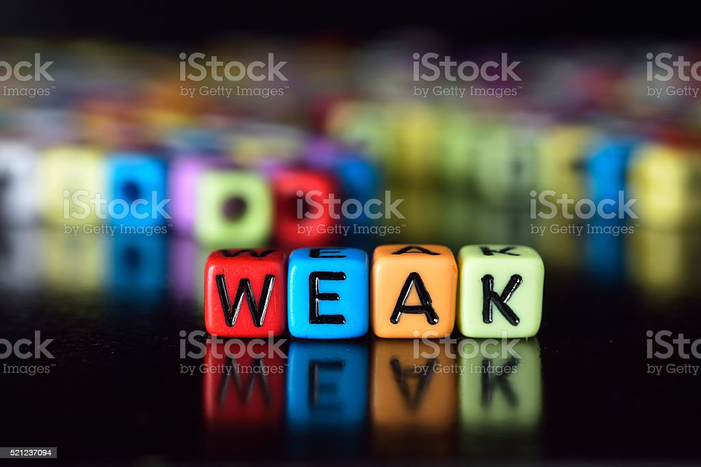 Weak on colorful dice stock photo