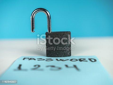 488497362 istock photo Weak password note and unlocked padlock 1162540327