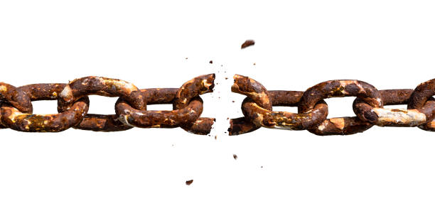 Weakest link breaking in old rusty chain photomontage stock photo