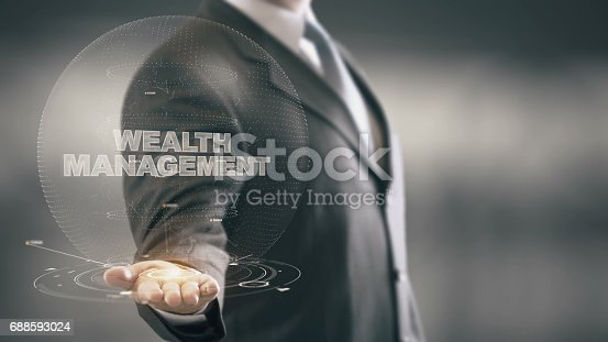 istock Wealth Management Businessman Holding in Hand New technologies 688593024