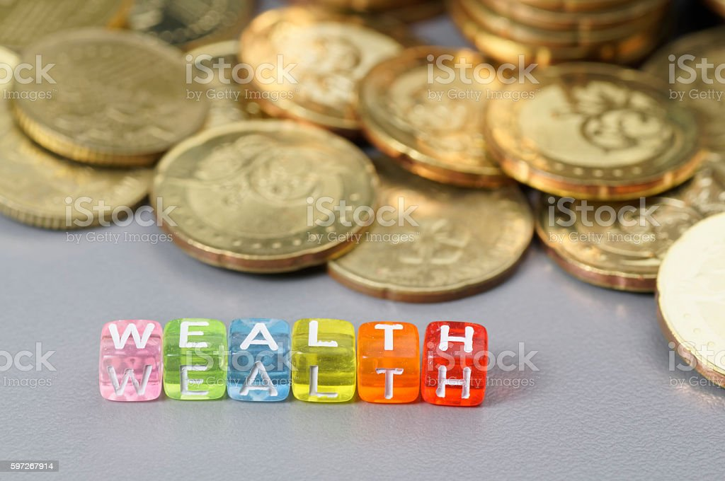 Wealth word on dice royalty-free stock photo
