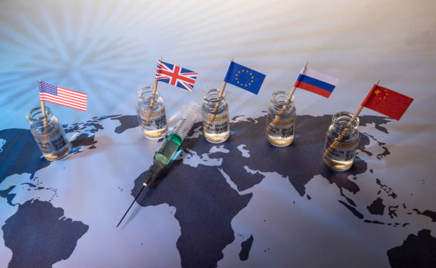 Wealthy country flags and vials on world map with vials for the global SARS/COVID pandemic vaccine war, with vaccine hoarding, restricting equal access to vaccines across the world, seen as a moral failure resulting in inequality stock photo
