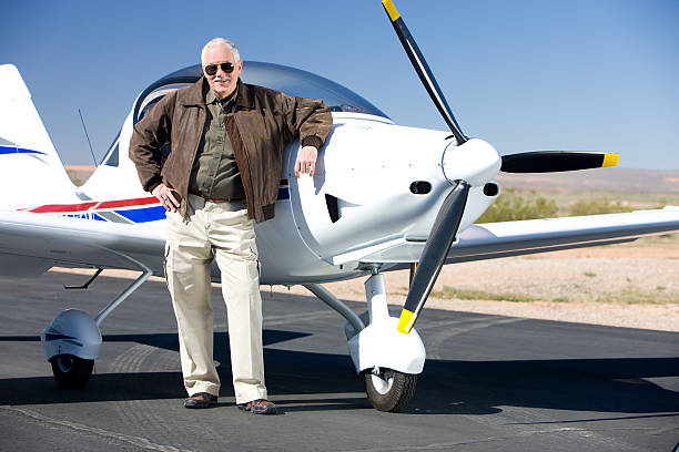 Wealthy Pilot with Modern Prop Aircraft stock photo