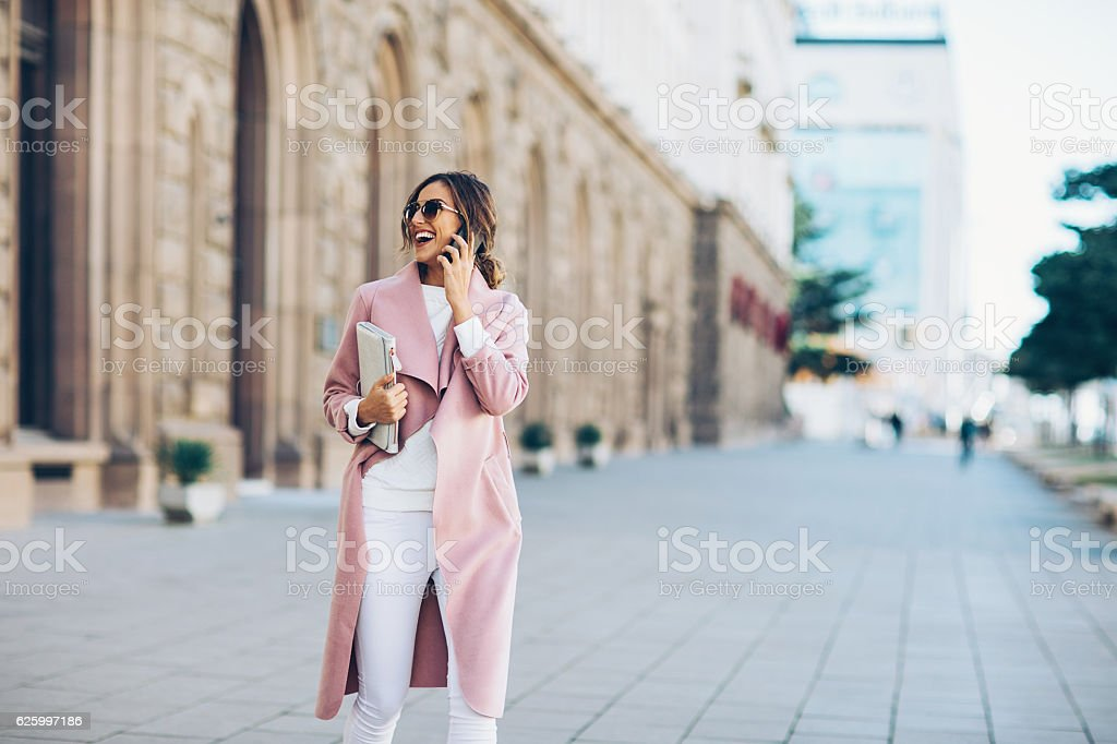 Wealthy woman outdoors in the city stock photo