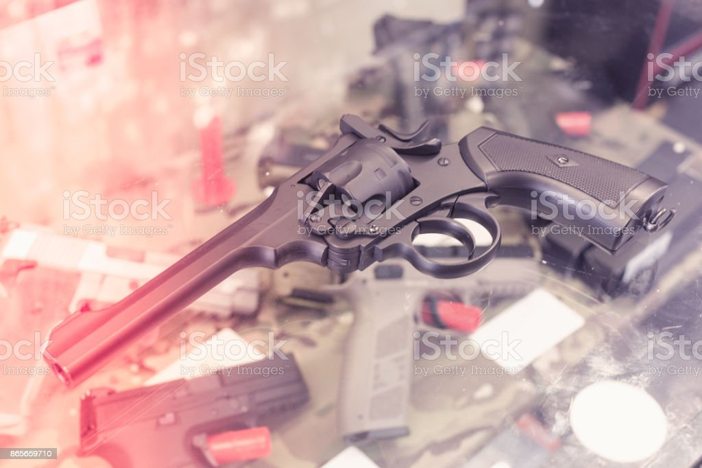 weapon on the glass table in army shop stock photo