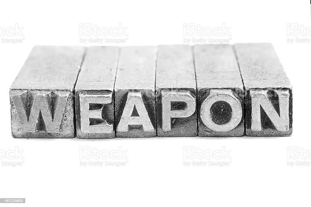 Weapon  sign, antique metal letter type royalty-free stock photo