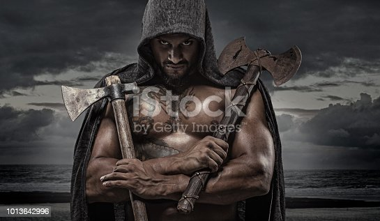 Weapon wielding Indian Descent warrior barbarian king alone in studio shoot