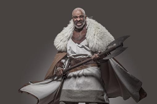 Weapon wielding viking inspired black african warrior