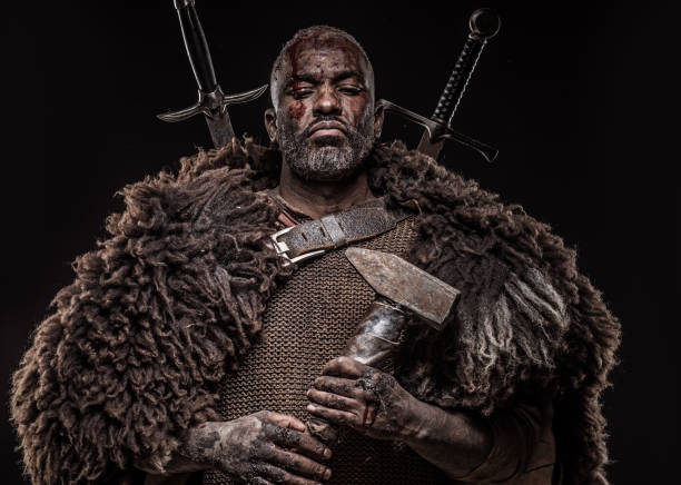 Weapon wielding viking inspired black warrior Weapon wielding viking inspired black warrior vikings stock pictures, royalty-free photos & images