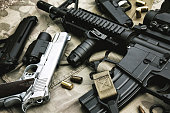 istock Weapons and military equipment for army, Assault rifle gun (M4A1) and pistol on camouflage background. 696928080