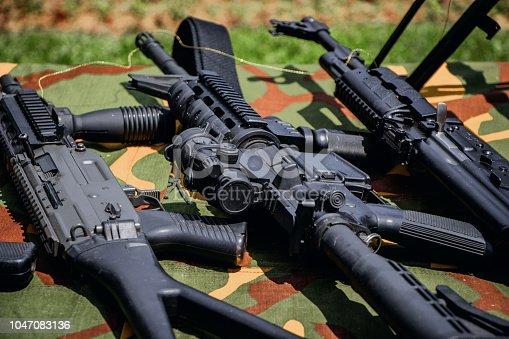 istock Weapons guns 1047083136