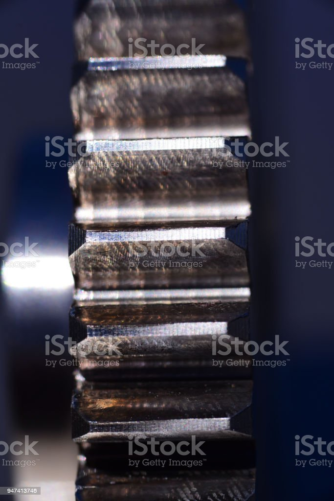Wear and lost metal on gear teeth due to misalignment of gear on shaft stock photo