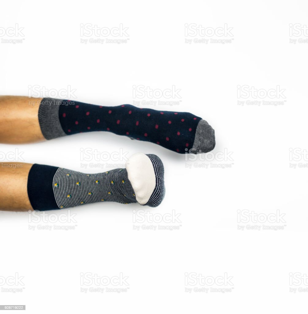 Wear different socks on white background stock photo