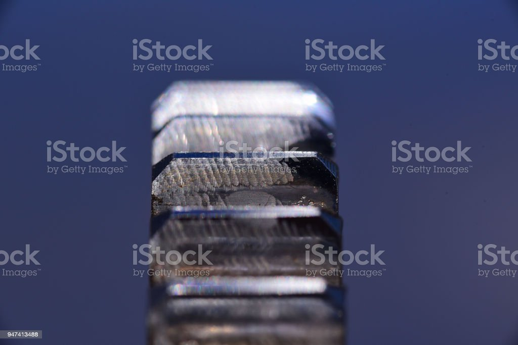 Wear on edge of gear teeth due to misalignment of gear on shaft stock photo