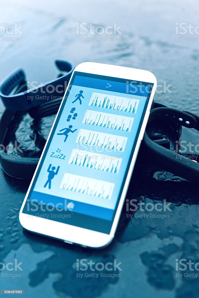 Wearable fitness trackers and mobile phone with an app stock photo