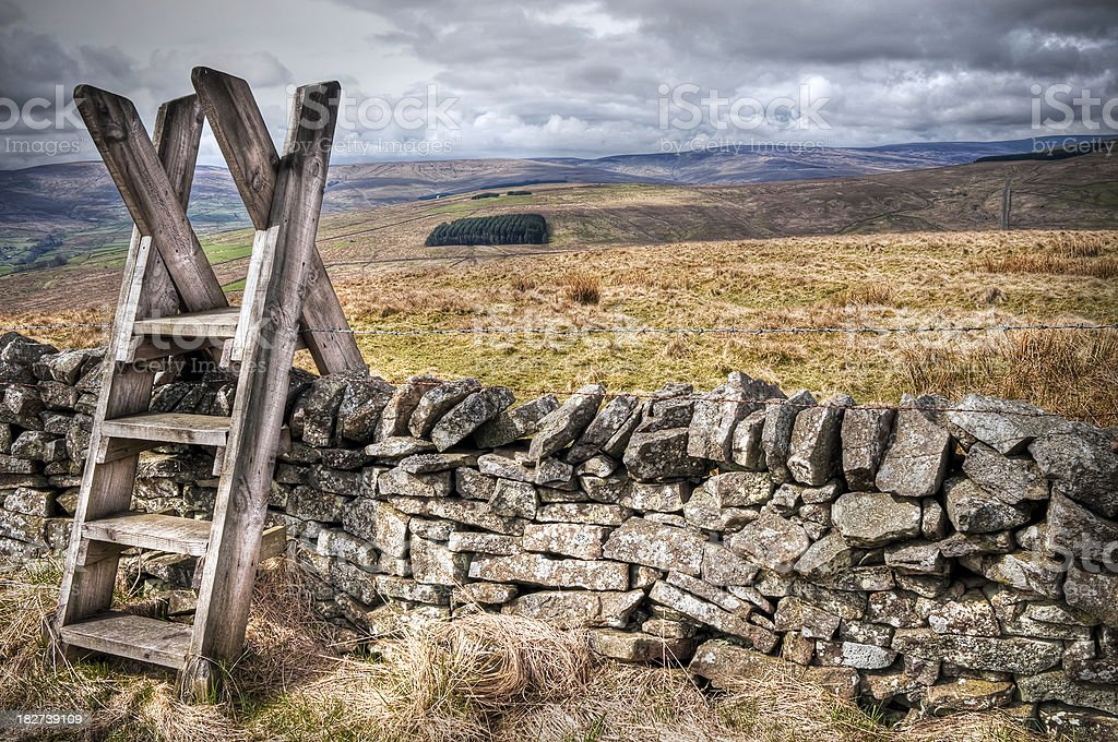 Weardale countryside view with wooden stile and stone wall, Durham stock photo