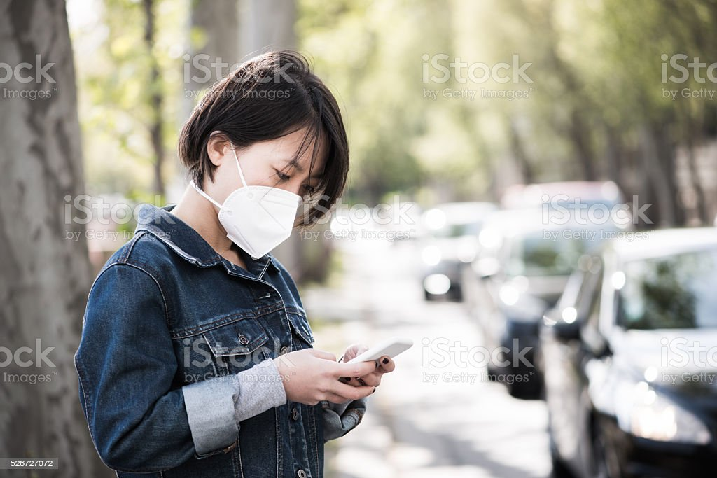 Wearing an Air Pollution Mask in the City stock photo