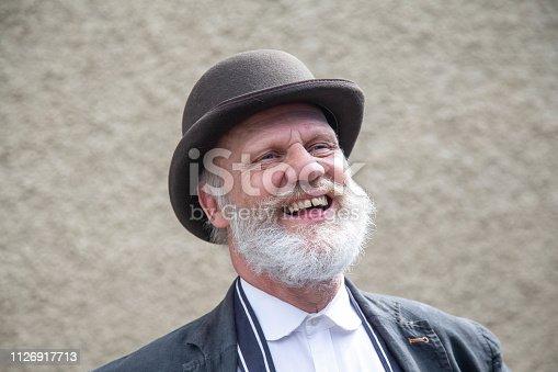 Past times - baker wearing bowler hat - mature man
