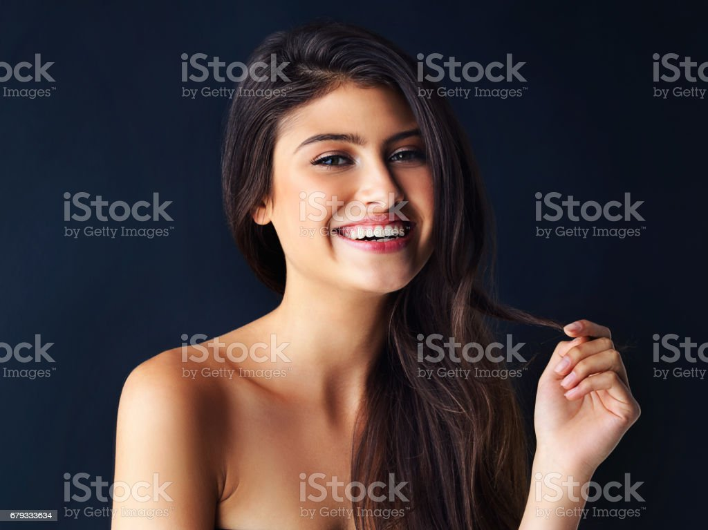 Wearing her sexiest smile stock photo