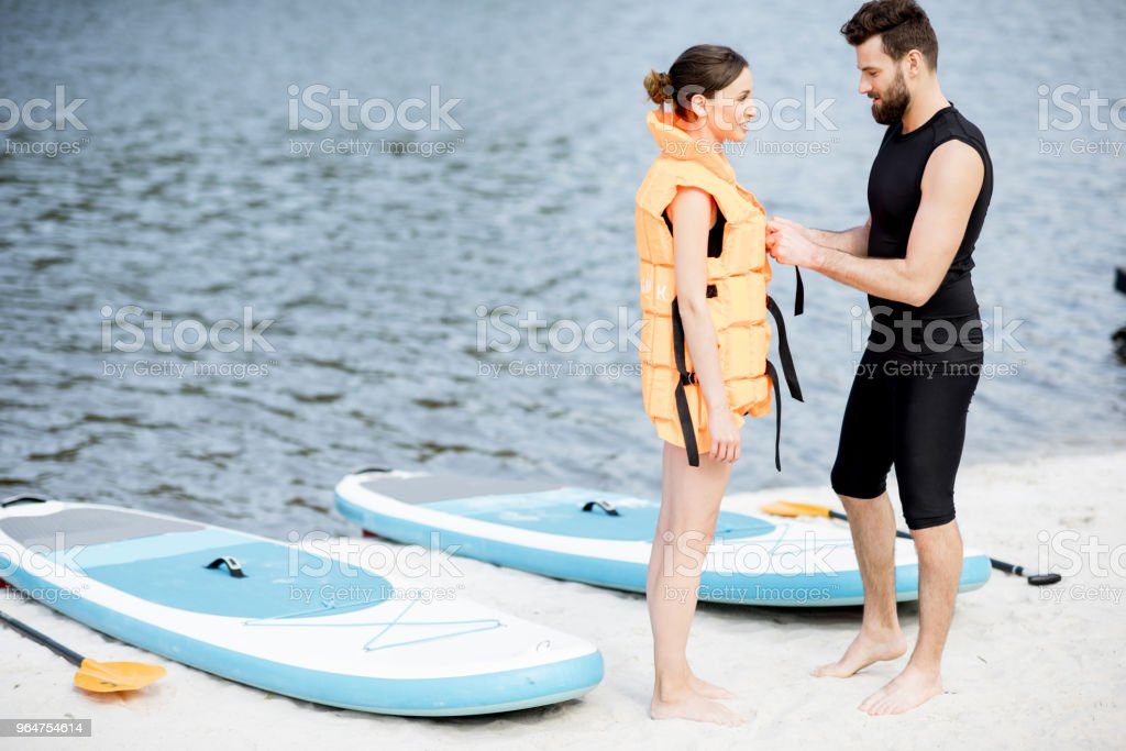 Wearing life vest on the beach royalty-free stock photo
