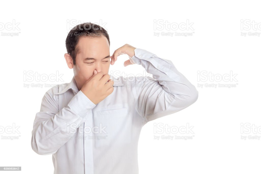 wearing shirt disgusting with bad smell of his wet armpit. stock photo