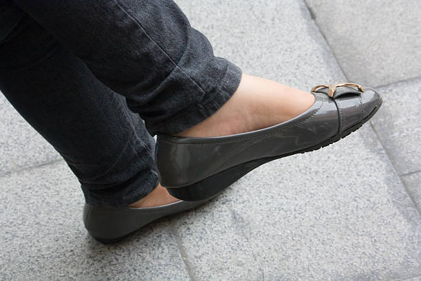 wearing shoes - flat shoe stock photos and pictures