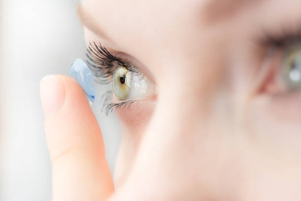 wearing soft contact lenses girl wearing soft contact lenses close-up macro lens eye stock pictures, royalty-free photos & images