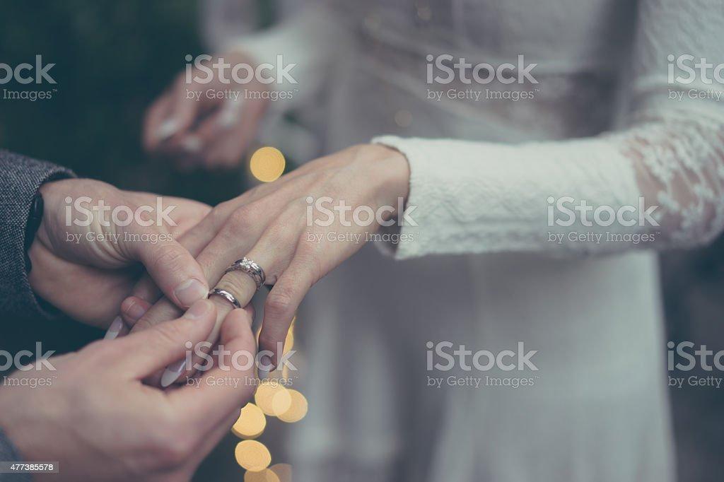 Wearing wedding rings stock photo