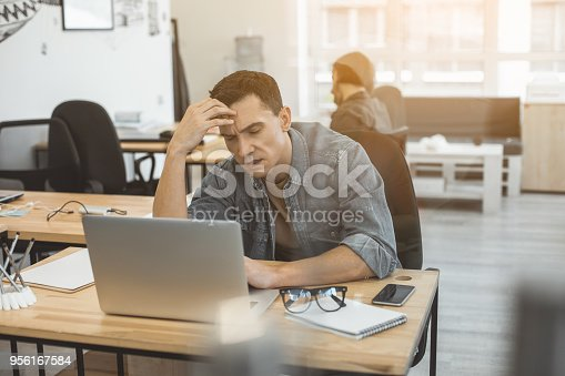 932342408istockphoto Weary employee having pain in head 956167584