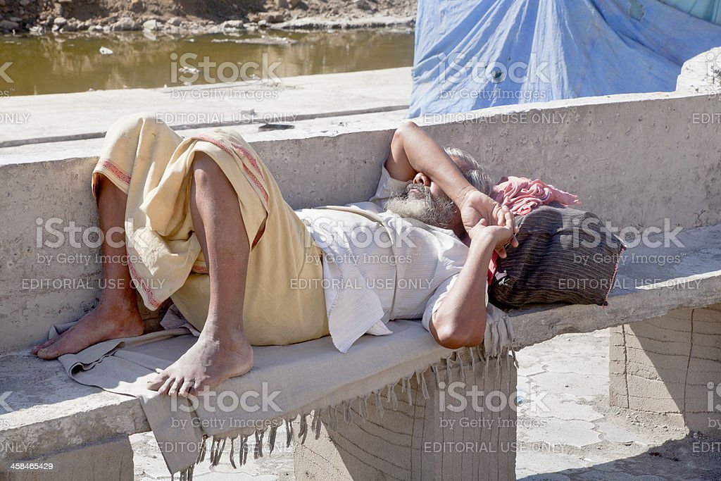 Weary foot traveler takes a rest royalty-free stock photo