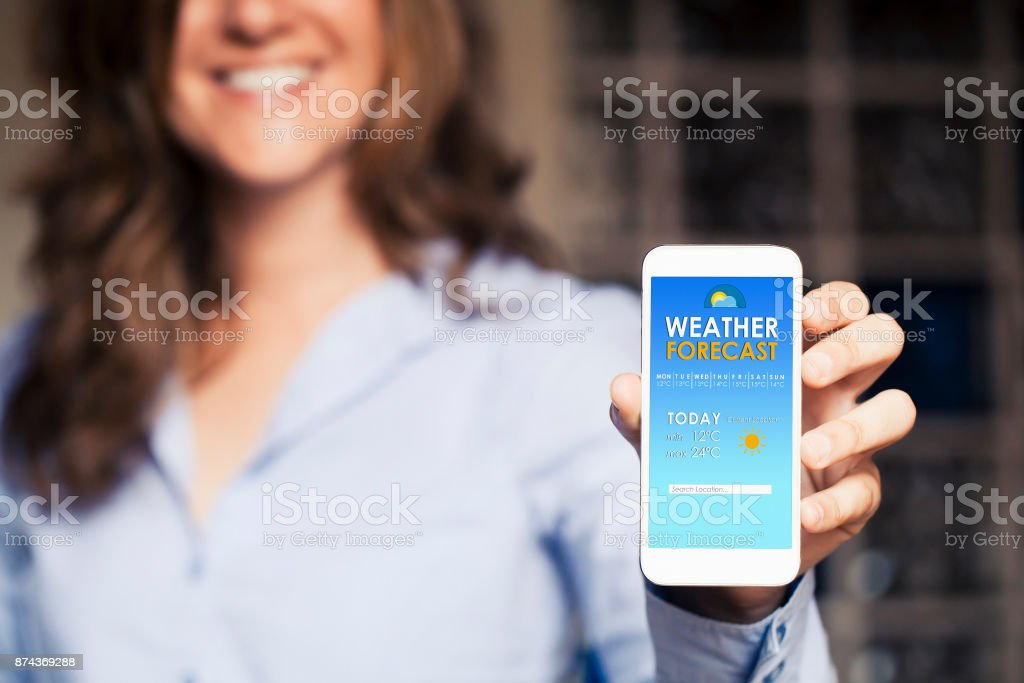 Weather forecast app in a mobile phone screen. stock photo