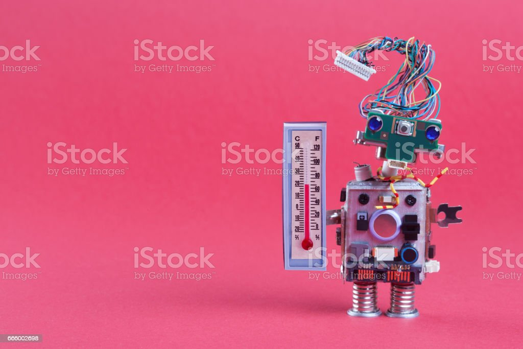 Weather forecasting concept photo. Robot weathermen with thermometer displaying comfort room temperature 21 degree celsius. Funny head robotic toy character on pink background, copy space royalty-free stock photo