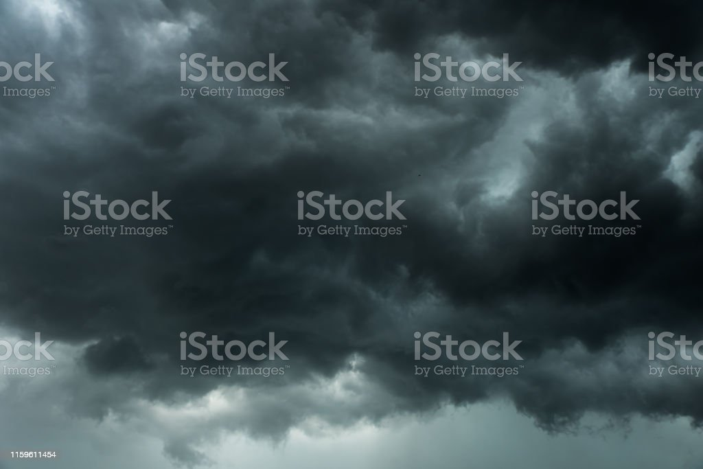 Weather in summer with black cloud and storm, Dark sky and dramatic...
