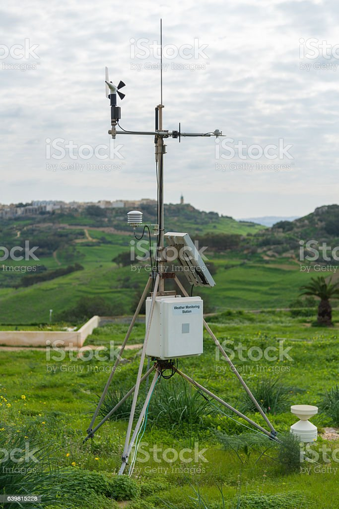 Weather monitoring station in landscape with different measurement