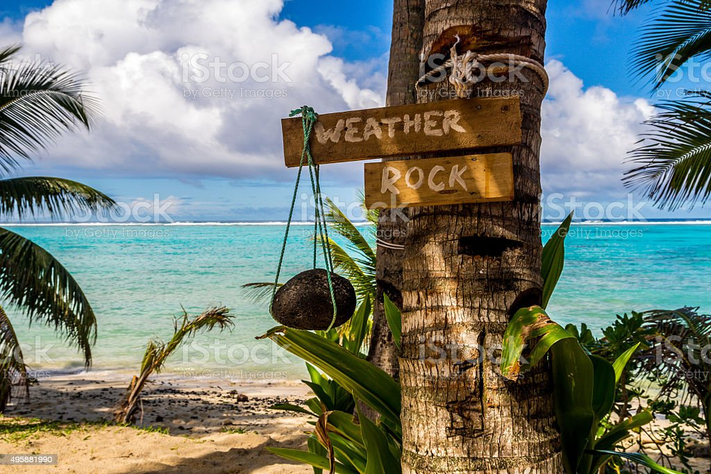 weather rock in a paradise beach stock photo