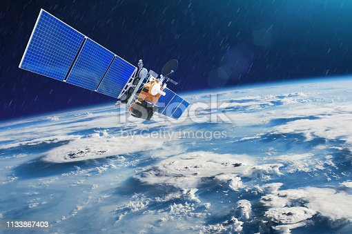istock Weather satellite for observing powerful thunderstorms of storms and tornadoes in space orbiting the earth. Elements of this image furnished by NASA 1133867403