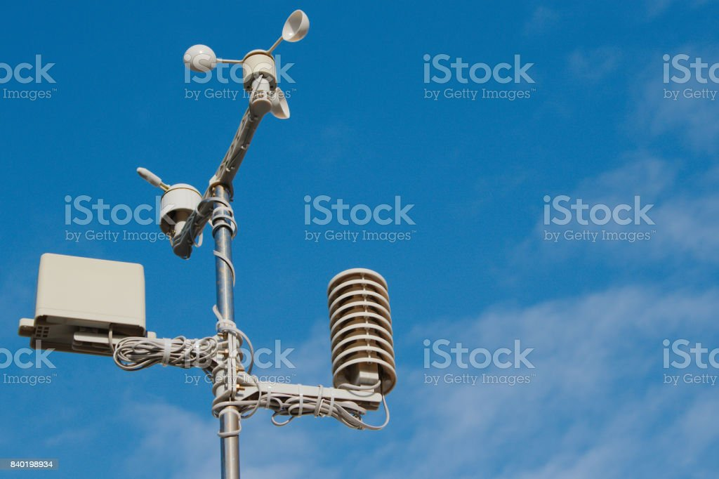 Weather station against an almost clear blue sky. stock photo