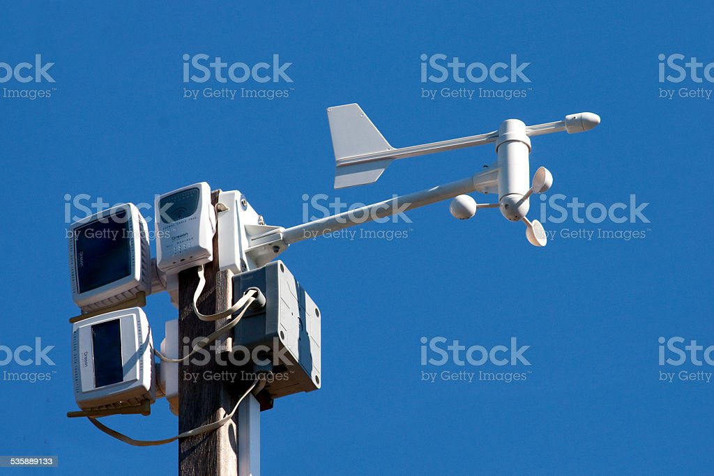 weather station against blue sky stock photo