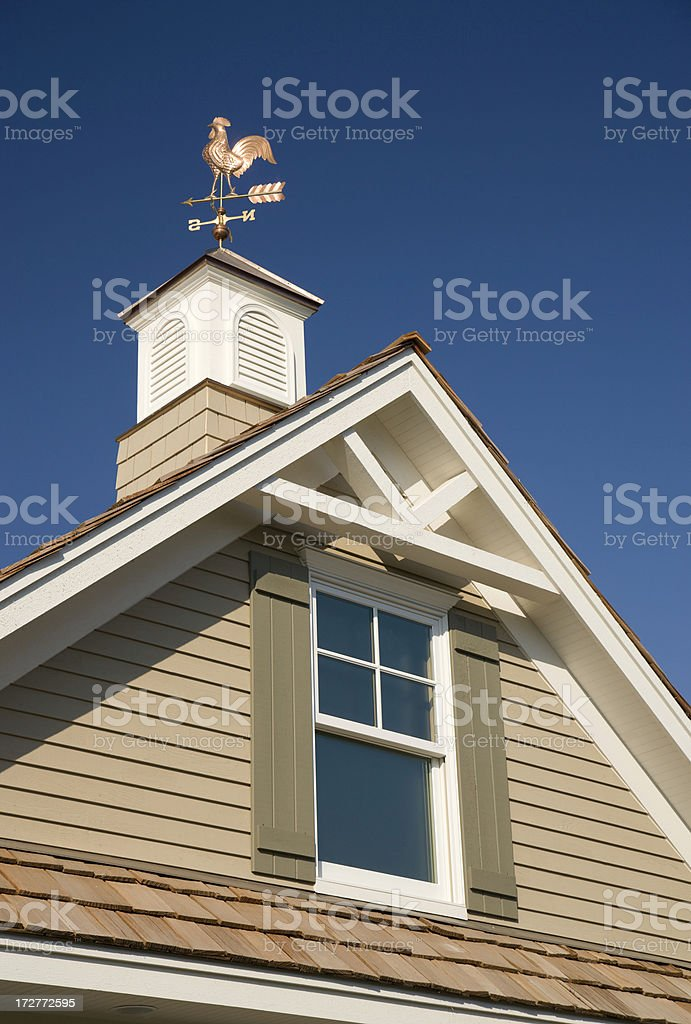 Weather vane and home peak. royalty-free stock photo
