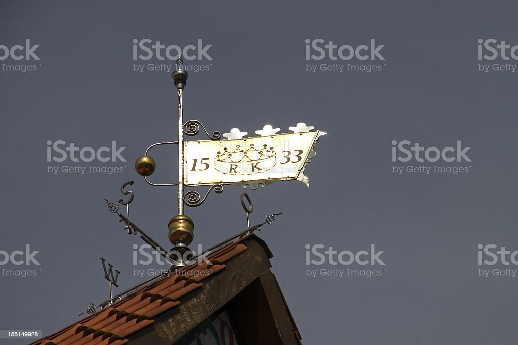 Weather vane on a roof in Bad Gandersheim stock photo