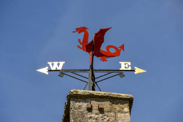 Weather vane on the historic town hall in Llantwit Major. Llantwit Major, Vale of Glamorgan, Wales - July 2018: Weather vane on the roof of the historic town hall in the South Wales village of Llantwit Major. The building dates back to the 15th Century south wales stock pictures, royalty-free photos & images